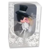 1 Couple de mariés s'embrassant, dans boîte à face visible