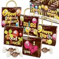 Ass. de pochettes humoristiques garnies de chocolats pralin  1 X12 pcs