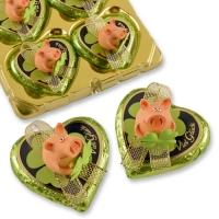 """Cochon """"porte bonheur"""" en polyrésine sur coeur praliné"""